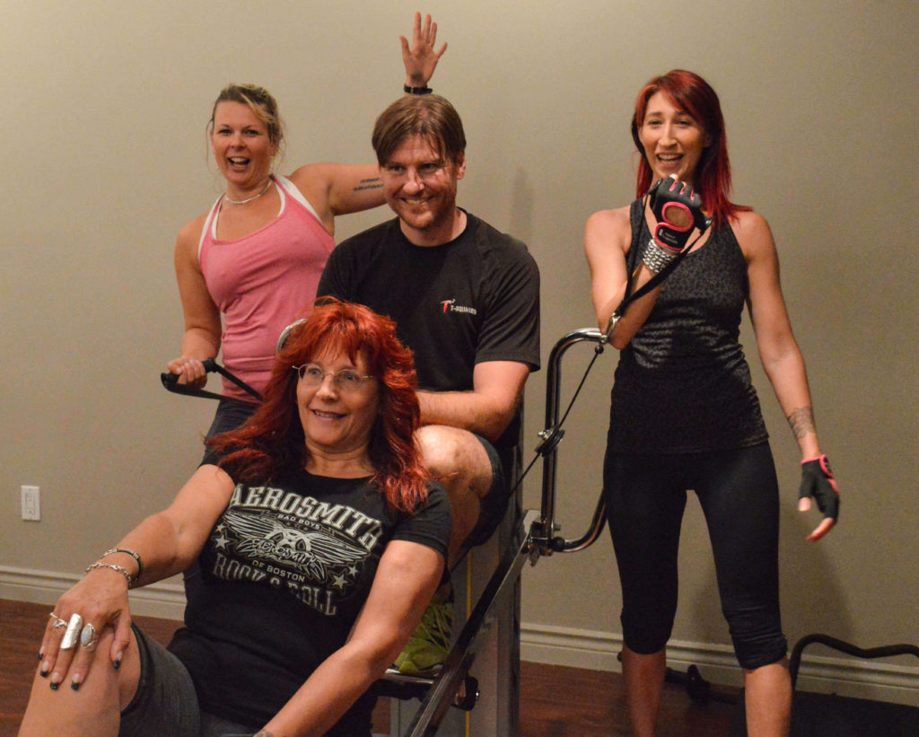 Life-changing Benefits of Group Fitness Classes Vancouver. Picture of Troy and happy clients.