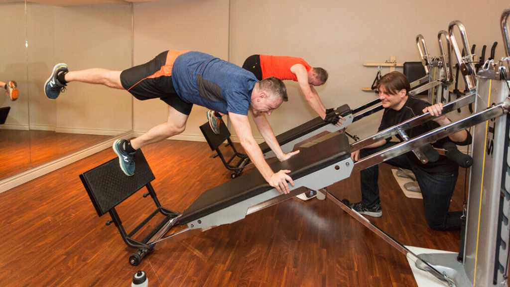 Secret Muscle Toning Workouts? Weightlifting Without Lifting Weights. Troy with his clients.