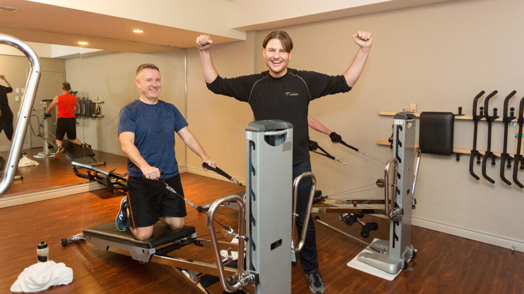 The Best Independent Personal Trainer Vancouver Gastown. Troy with his client.