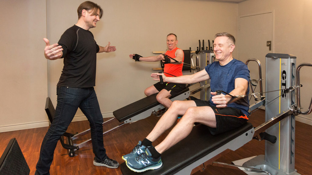 Why Enroll in Fitness Classes Downtown Vancouver? Troy with two of the clients.