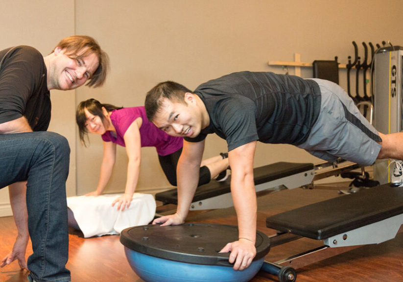Healthier Future with Best Workout Classes Vancouver, Troy hands-on with his clients.