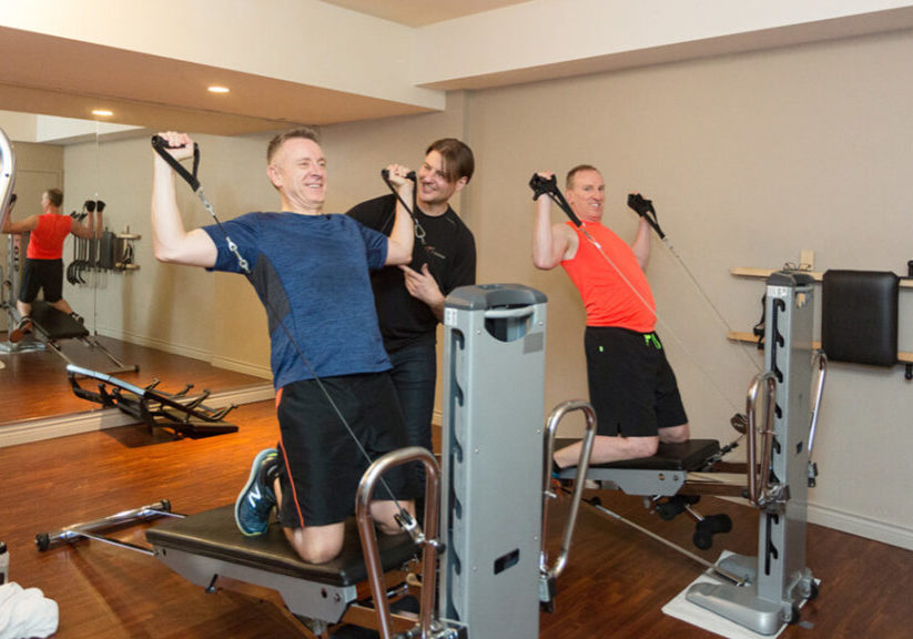 Maximize Your Exercise in Vancouver Using Total Gym. Troy with his clients.