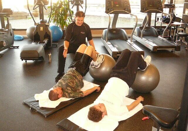 Weightlifting Personal Trainer. Troy with the clients for a personal training session.