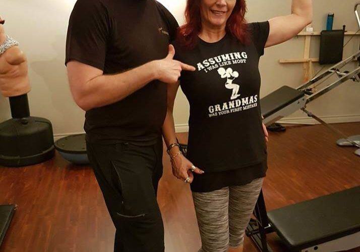 Why Hire a Personal Trainer? Find out! Troy with his client.