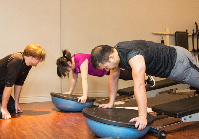 Your Simple Crossfit Workout Vancouver Principles. Troy with his clients.